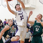 Keystone's Chase Robison goes up for a shot between Cloverleaf's Robbie Buckwald, left and Jayson Sykora during the second quarter. (RON SCHWANE / CT)
