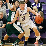 Keystone's Austin Conrad drives around Cloverleaf's Brandon Johnson during the first quarter. (RON SCHWANE / CT)