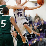 Keystone's Adam Hopkins goes up for a shot after beating Cloverleaf's Jayson Kykora and Clifford Collyer during the first quarter. (RON SCHWANE / CT)