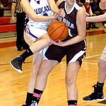 Keystone's #12 Jennifer Schaffer fights Padua's #21 Savannah Heckelmoser for the rebound.