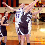 Keystone's #24 Jillian Peters and Padua's #32 Lea Walsh reach for the rebound.