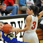 Sharday Baines, left, of Lake Ridge collides with Emily Yoder of Hiland last night in the third quarter. DAVID RICHARD / CHRONICLE