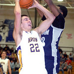 Avon's #22 Matt Lawrence tries to shoot past Lorain's #13 Devon Andrews.