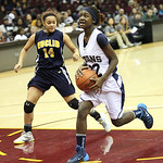 Lorain's Tremia Blair goes for a layup in the first half against Euclid's Erin Haislah. RAY RIEDEL/CHRONICLE