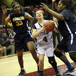 Euclid's Shawnte Farely, left, and Raquel Latimer pressure Lorain's Gretchen Conibear. RAY RIEDEL/CHRONICLE