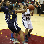 Euclid's Alexis Hoxie, center, and Raquel Latimer pressure Lorain's Sade McCall inside the paint. RAY RIEDEL/CHRONICLE
