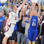 Midview Grant Overy hits a three pointer over Wellington Dylan Kidd Dec. 4.  Steve Manheim