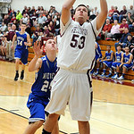 Wellington Jake Miller goes to hoop past Midview Grant Overy in first half Dec 4.  Steve Manheim