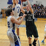 EC 32 John Stursa goes to hoop over midview 22 Steven Gott and 2 Wes Davic Dec. 11. Steve Manheim