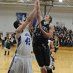 EC Cory Strasko goes to hoop over Midview Jack Duffner Dec. 11.  Steve Manheim