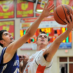 Midview's Jack Duffner, left, reaches for a rebound against Nolan Gerrity of Midpark last night in the first quarter. DAVID RICHARD / CHRONICLE