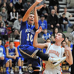 Devin Dombrowski, left, of Midview puts up a shot against Midpark's Michael Schuller in the fourth quarter. DAVID RICHARD / CHRONICLE
