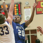 Midview's #20 D.J. Johnson and North Royalton's #33 Mckay Snyder.   photo by Chuck Humel