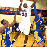 Oberlin's #30 Dominic Taylor tries to shoot past Clearview's #13 Deshawn Carter & #3 Jacob Senquiz.