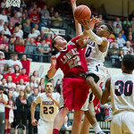 Oberlin's #10 Jason Moore gets fouled on his way to the hoop by LaBrae's #22 Nate Middleton.