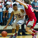 Oberlin's Jason Moore dirves past LaBrae's #23 John Richards.
