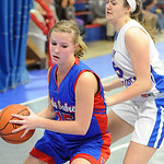 First Baptist Tori Odle grabs a rebound against Open Door Christa Mindling Dec. 20.  Steve Manheim