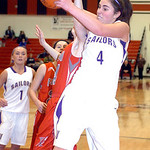 Vermilion's #4 Andrea Dillon fights Fairview's #24 Rachel Malloy for the rebound.