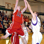 Firelands #12 Nicholas Bauer tries to shoot past Vermilion's #23 Ryan Miller.