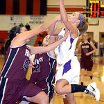 Vermilion's #1 AuBree LaForce fights to shoot past Rocky River's #14 Andrea Chiviles and #12 Nichole Popovich.