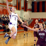 Vermilion's #2 Hannah Bartlome leaps for the basket past Rocky River's #14 Andrea Chiviles.