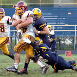 Avon Lake&#039;s Collin Lucas digs for more yardage while dragging North Ridgeville&#039;s Shawn Stumpf as Jacob Ruoff pursues.<br /> Linda Murphy/Chronicle