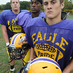 Kevin Skotko, front, linebacker,  Ross Douglas, cornerback, and Alex Kelly, defensive lineman for Avon football on Oct. 3.   Steve Manheim