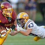 Avon linebacker Tyler Matuszak, right, dives for running back Anthony Thielman of Avon Lake in the second quarter.<br /> DAVID RICHARD / CHRONICLE