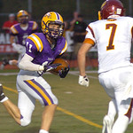 Avon&#039;s Braeden Friss runs for yardage past Avon Lake&#039;s David Winkel.<br /> Photo by Linda Murphy