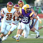 Avon&#039;s Gerett Choat runs for yardage past Avon Lake&#039;s Turner Keane, left, and Danny Disbrow.<br /> Photo by Linda Murphy