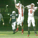 Elyria's #6 Dan Ratliff celebrates a touchdown and follow up run for a touchdown with teammate Darrin Terry.