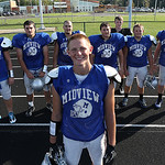 Getting by with a little help from his friends is Midview reciever Eric Lauer. Behind him is the line and his quarterback. Lauer had a record setting night against Elyria High.