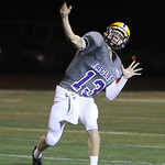 ANNA NORRIS/CHRONICLE<br /> Avon quarterback Tommy Glenn completes a pass down field against Elyria Catholic in the second quarter Friday night at Avon Stadium.