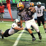 ANNA NORRIS/CHRONICLE<br /> Avon wide receiver MIchael Nose slips through the tackle of Elyria Catholic&#039;s 4 (need name) in the first quarter Friday night at Avon Stadium.