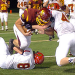 Avon Lake's Kyle Kuhar is stopped by Brecksville's Matt Zakelj, left, and Colton Czack. LINDA MURPHY/CHRONICLE