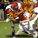 Avon Lake's Jace Russell is stopped by Brecksville's Joe Mandato. LINDA MURPHY/CHRONICLE
