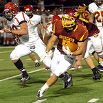 Avon Lake's Wyatt Ohm runs for yardage with Brecksville's Joe Mandato in pursuit. LINDA MURPHY/CHRONICLE
