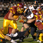 Avon Lake's Collin Lucas tries for more yardage against North Olmsted's Luke Janik. LINDA MURPHY/CHRONICLE