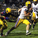 ANNA NORRIS/CHRONICLE<br/>Avon tight end Chris Maxwell breaks through the North Ridgeville defense for the first down in the second quarter Friday night at North Ridgeville.
