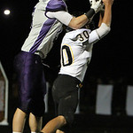 ANNA NORRIS/CHRONICLE<br /> Keystone&#039;s C.J. Concrad goes up for the long pass from quarterback Tyler Gullett with coverage by Black River&#039;s David Bell in the first half Friday night at Keystone Hi &#8230;