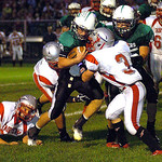 10-4-13 linda murphy</p> <p>columbia&#039;s quarterback #8 Jay Banyasz  digs for yardage against fairview&#039;s #3 Austin Fox.