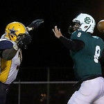 North Ridgeville's Bailey Gannon deflects a pass by Elyria Catholic's Jeremy Holley. BRUCE BISHOP/CHRONICLE
