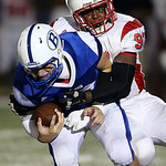 Elyria's Isaac Miller sacks Brunswick quarterback Steven Ficyk during the second quarter. (RON SCHWANE / GAZETTE)