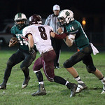EC's Justin Rankin gets help from Conner Riddell to beat Rocky River defender Cam Heider. RAY RIEDEL/CHRONICLE