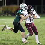 Elyria Catholic's Jerot Schill drives Rocky River quarterback Matt Lowery out of bounds in the first half at Knights of Columbus field. RAY RIEDEL/CHRONICLE