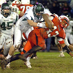 Elyria's Jumarr Lewis digs for more yardage as Medina's Kenny Wilder tries to bring him down. LINDA MURPHY/CHRONICLE
