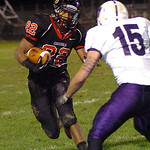 Brookside's Arin Pruitt tries to run for yardage past Keystone's Nick McLaughlin. LINDA MURPHY/CHRONICLE