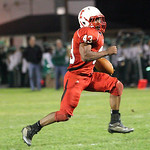 Jumarr Lewis breaks away for a long touchdown run at Elyria High Stadium. Ray Riedel/Chronicle