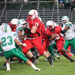Elyria tackle Seth Billings helps clear a path for Jordan Connell. Ray Riedel/Chronicle
