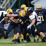 13SEP13_North Ridgeville's Noah Whipkey hammers his way to gain some yards before being brought down by North Olmsted's Chris Lewis (45) and Zach Jones (76) at North Ridgeville High School. …
